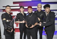 File - This Oct. 17, 2019, file photo shows Erick Brian Colon, from left, Christopher Velez, Richard Camacho, Zabdiel de Jesus and Joel Pimentel, of CNCO, posing backstage with the awards for favorite pop artists and favorite duo or group at the Latin American Music Awards in Los Angeles. The Latin American boy band CNCO is downsizing. The group announced on its official Instagram page Sunday, May 9, 2021, that 22-year-old Pimentel is leaving the band, making the successful quintet a quartet. (Photo by Richard Shotwell/Invision/AP, File)