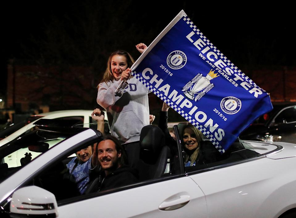 Leicester City fans celebrate outside the King Power stadium after their team won the Premier League title in Leicester, Britain May 3, 2016. REUTERS/Eddie Keogh