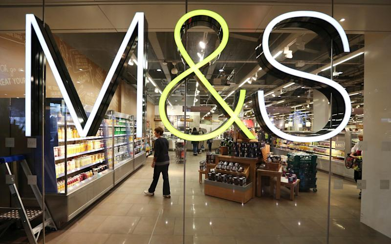 Marks & Spencer's profits have been dragged down by the costs of closing stores