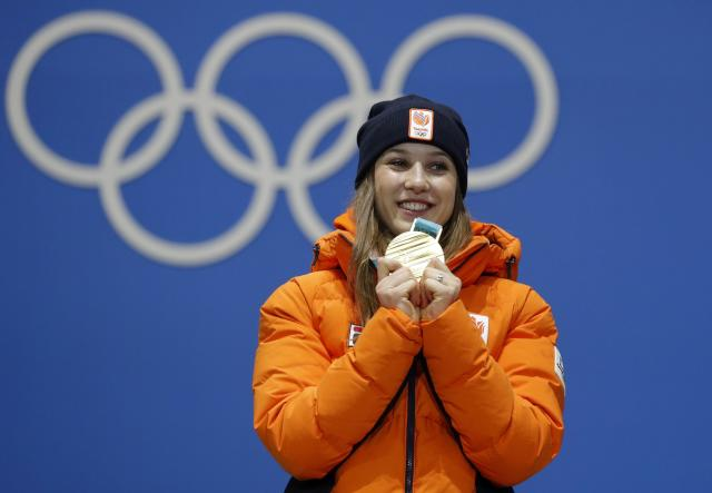 Medals Ceremony - Short Track Speed Skating Events - Pyeongchang 2018 Winter Olympics - Women's 1000m - Medals Plaza - Pyeongchang, South Korea - February 23, 2018 - Gold medalist Suzanne Schulting of the Netherlands on the podium. REUTERS/Eric Gaillard