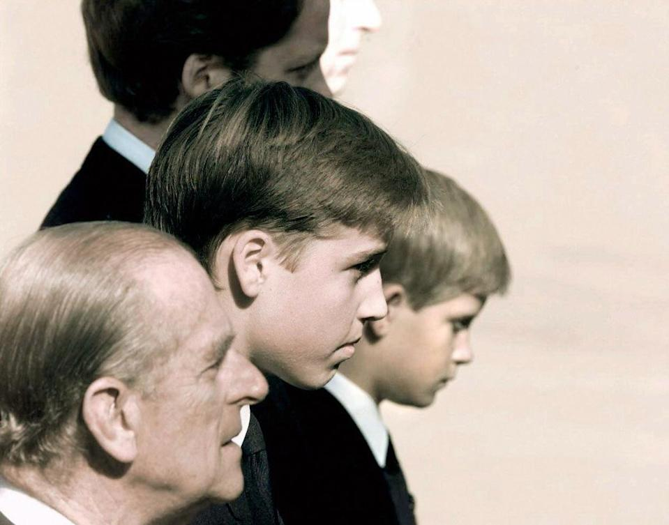 <p>Prince William and Prince Harry had their grandfather by their side as they faced the world at their mother's funeral in 1997. Photo: Getty Images.</p>