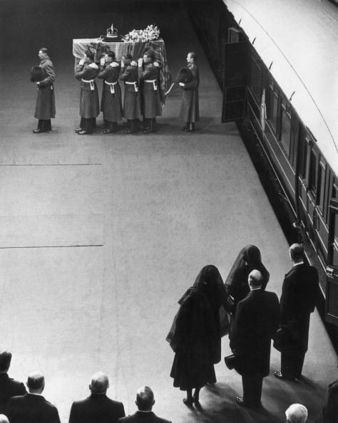 """<p>King George VI dies on February 6. Princess Elizabeth becomes Queen Elizabeth II, with Queen Elizabeth taking the name """"Queen Mother"""" to avoid confusion between the two. Here, they watch the funeral proceedings. </p>"""