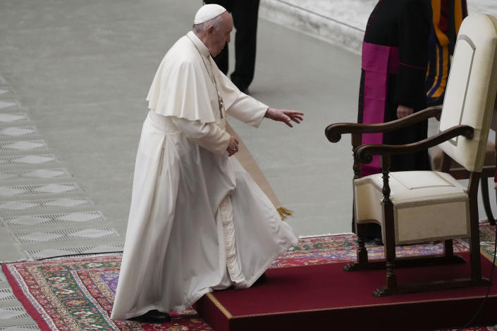 Pope Francis arrives to meet with the participants of the inter-parliamentary meeting on the COP26 in the Paul VI Hall at the Vatican, Saturday, Oct. 9, 2021. (AP Photo/Gregorio Borgia)