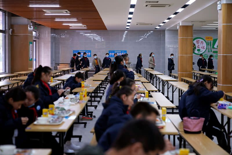 Students arrive at a restaurant for lunch at Minhang Experimental High School amid the global outbreak of the coronavirus disease (COVID-19) in Shanghai
