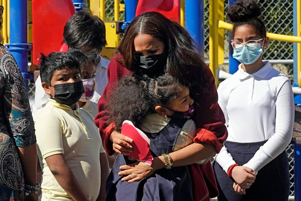 Duchess Meghan is hugged by a student during a visit to P.S. 123, the Mahalia Jackson School, in New York's Harlem neighborhood on Sept. 24, 2021.
