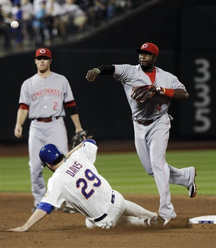 Cincinnati Reds second baseman Brandon Phillips (4) throws to first base after forcing out New York Mets' Ike Davis (29) during the sixth inning of a baseball game on Saturday, June 16, 2012, in New York. Josh Thole was safe at first base on the play. (AP Photo/Frank Franklin II)