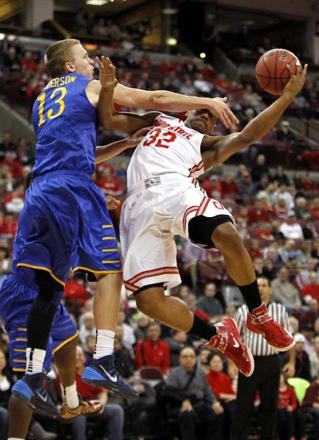 Delaware's Kyle Anderson, left, fouls Ohio State's Lenzelle Smith Jr. during the first half of an NCAA college basketball game in Columbus, Ohio, Wednesday, Dec. 18, 2013. ( AP Photo/Paul Vernon)