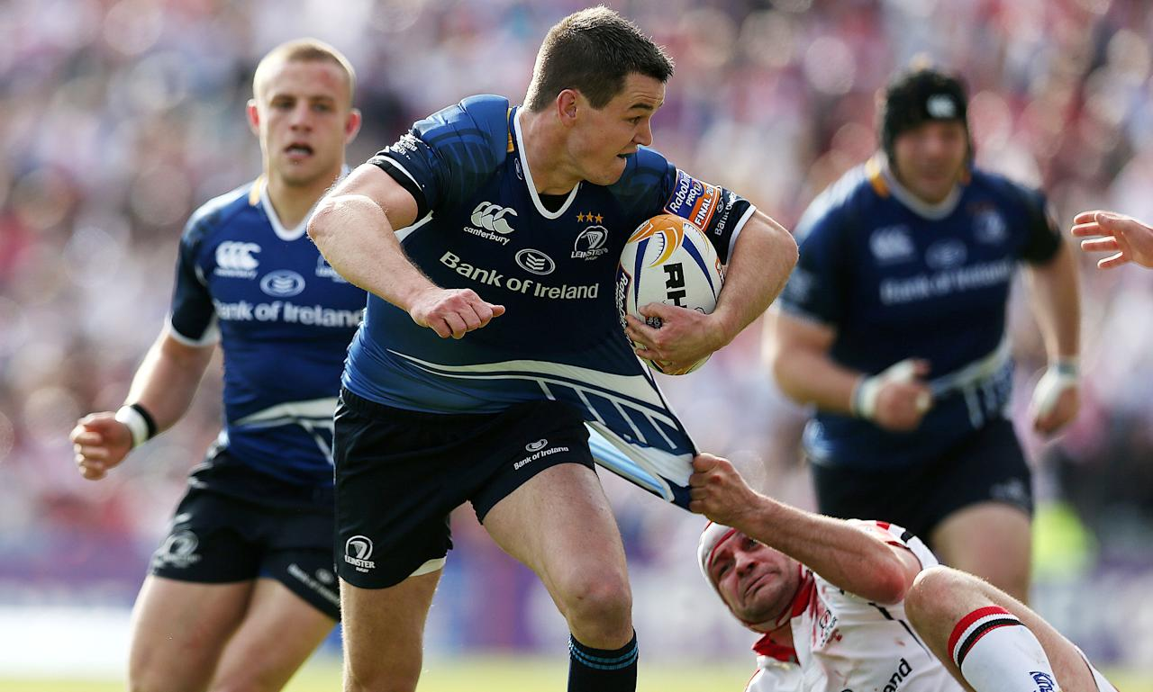 Leinster's Jonny Sexton escapes a tackle from Ulster's Rory Best during the RaboDirect PRO12 Final at the RDS, Dublin, Ireland.