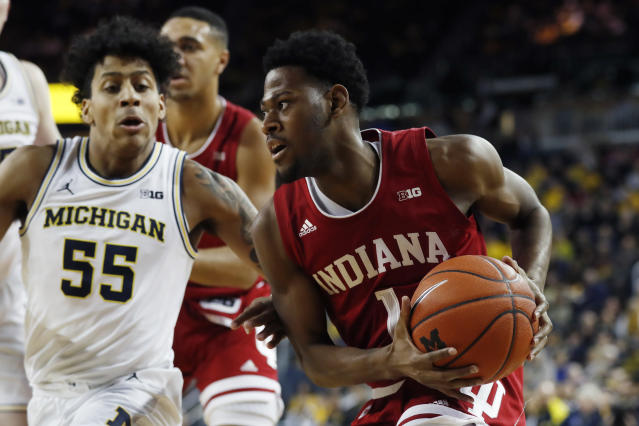 Indiana guard Al Durham (1) is defended by Michigan guard Eli Brooks (55) during the first half of an NCAA college basketball game, Sunday, Feb. 16, 2020, in Ann Arbor, Mich. (AP Photo/Carlos Osorio)