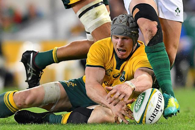 Rugby Union - June Internationals - Australia vs Ireland - Lang Park, Brisbane, Australia - June 9, 2018 - David Pocock of Australia dives on the ball. AAP/Darren England/via REUTERS ATTENTION EDITORS - THIS IMAGE WAS PROVIDED BY A THIRD PARTY. NO RESALES. NO ARCHIVE. AUSTRALIA OUT. NEW ZEALAND OUT.