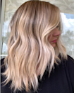 """According to Chicago colorist <a href=""""https://www.instagram.com/colorbyrex/"""" rel=""""nofollow noopener"""" target=""""_blank"""" data-ylk=""""slk:Rex Jimieson"""" class=""""link rapid-noclick-resp"""">Rex Jimieson</a>, his clients have been moving away from the darker roots and lighter ends they've been loving in recent seasons. Instead they've been asking for a look that Jimieson dubbed <a href=""""https://www.glamour.com/story/tweed-hair-color?mbid=synd_yahoo_rss"""" rel=""""nofollow noopener"""" target=""""_blank"""" data-ylk=""""slk:tweed hair"""" class=""""link rapid-noclick-resp"""">tweed hair</a>, essentially subtle highlights that are evenly distributed. """"A contrast is still present, but not as 'overachiever' as seen in recent seasons,"""" he says. One of our favorite versions of the look? This ashy blond with lighter balayage pieces from <a href=""""https://www.instagram.com/simplicitysalon/"""" rel=""""nofollow noopener"""" target=""""_blank"""" data-ylk=""""slk:Simplicity Salon"""" class=""""link rapid-noclick-resp"""">Simplicity Salon</a> in south Florida."""