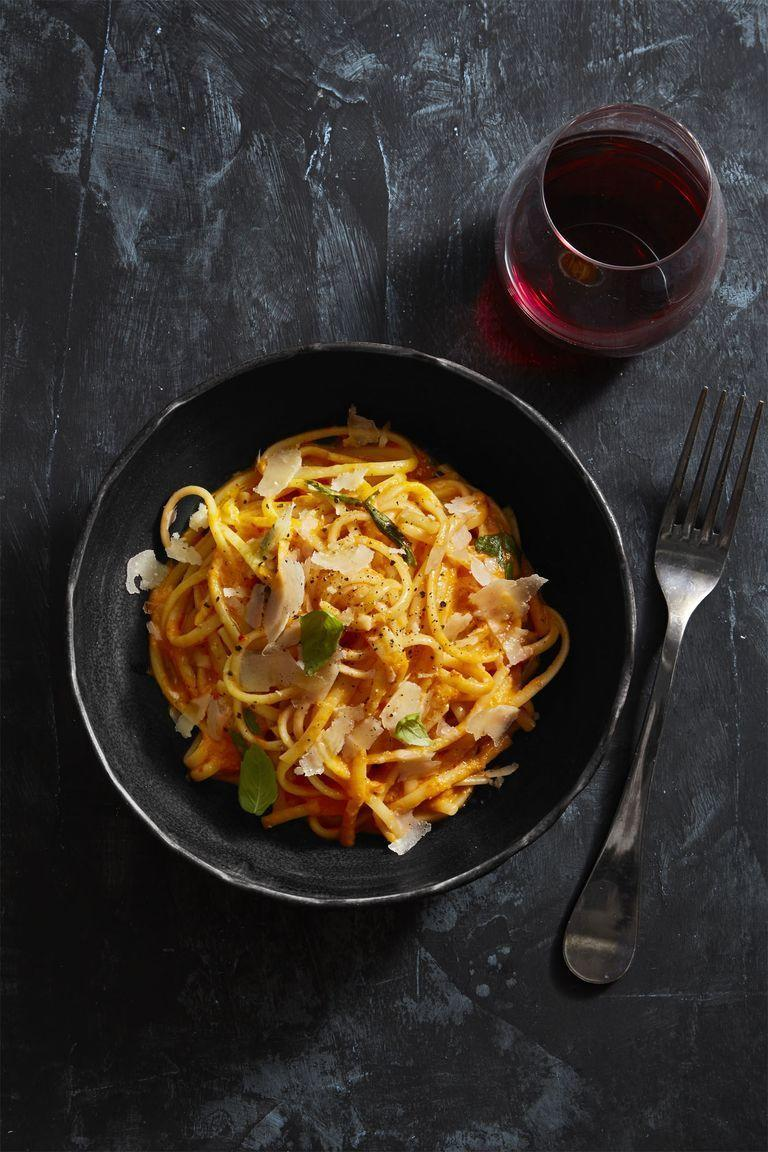 """<p>Making a creamy, vegetarian-friendly Alfredo sauce from scratch sounds like a fun kitchen task on Christmas. It's made easier thanks to the blender's quick work in blitzing roasted peppers and cream into a lavish sauce.</p><p><em><a href=""""https://www.goodhousekeeping.com/food-recipes/easy/a25656911/pasta-with-red-pepper-alfredo-recipe/"""" rel=""""nofollow noopener"""" target=""""_blank"""" data-ylk=""""slk:Get the recipe for Pasta With Red Pepper Alfredo »"""" class=""""link rapid-noclick-resp"""">Get the recipe for Pasta With Red Pepper Alfredo »</a></em></p>"""
