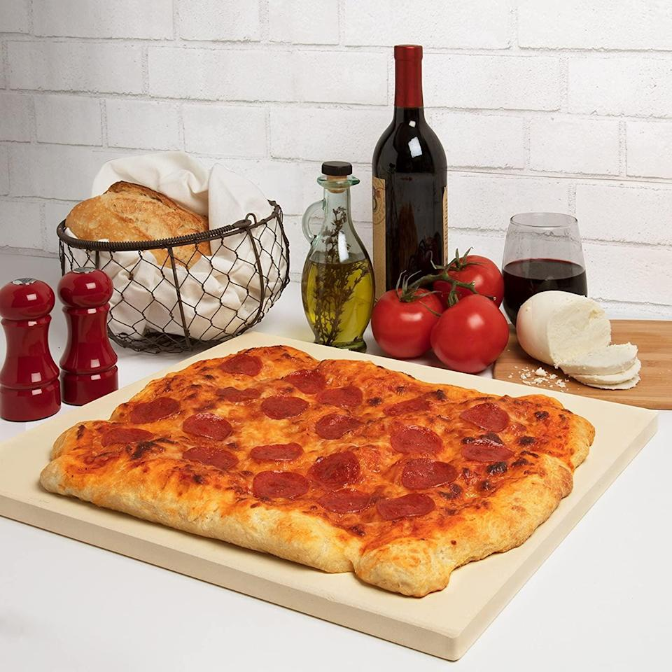 <p>You'll be tempted to watch Netflix and eat pizza every day with this <span>CucinaPro Pizza Stone</span> ($40, originally $50).</p>