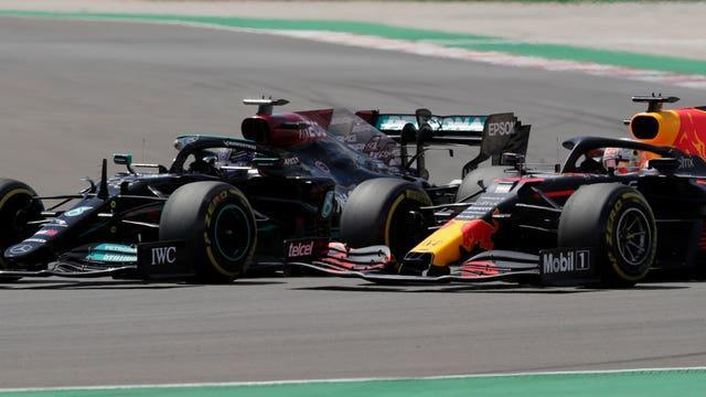Max Verstappen and Lewis Hamilton battle for the lead during the Portugal Grand Prix