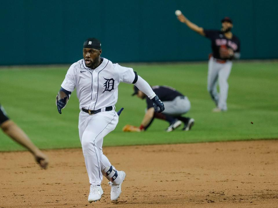 Tigers center fielder Akil Baddoo runs towards third base against Cleveland during the seventh inning at the Comerica Park on Tuesday, May 25, 2021.