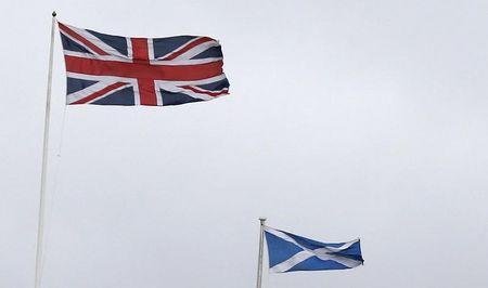 Union Jack and Saltire flags fly outside the Lloyds Banking Group Scottish Headquarters in Edinburgh, Scotland