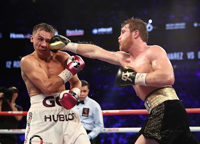Canelo Alvarez punches Gennady Golovkin during their WBC/WBA middleweight title fight at T-Mobile Arena on Saturday in Las Vegas. (Getty Images)