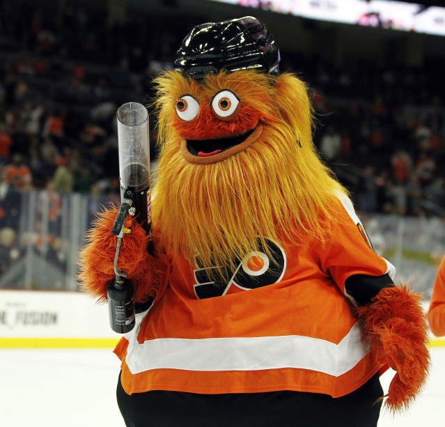 In this Sept. 24, 2018, file photo, the Philadelphia Flyers mascot, Gritty, takes to the ice during the first intermission of the Flyers' preseason NHL hockey game against the Boston Bruins in Philadelphia. Gritty will continue to be must-see _ but his postseason debut will have to wait at least one more season. (AP Photo/Tom Mihalek, File)