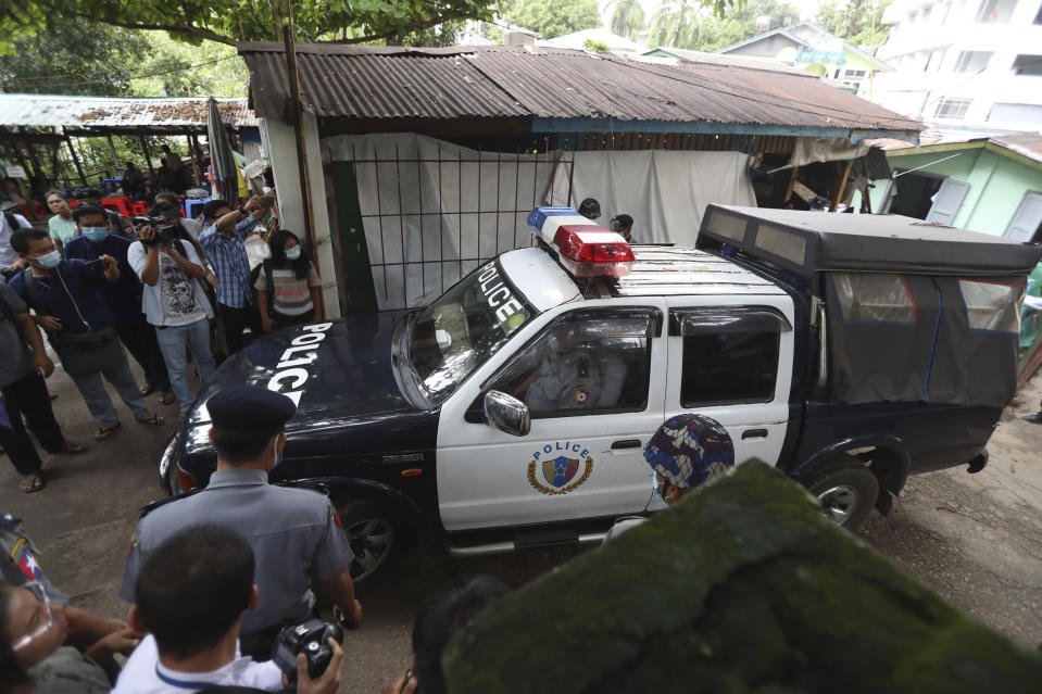 A police vehicle carrying Canadian pastor David Lah leaves a township court after a hearing Thursday, Aug. 6, 2020, in Yangon, Myanmar. The court has sentenced Lah to three months imprisonment after finding him guilty of violating a law intended to combat the spread of the coronavirus. (AP Photo/Thein Zaw)