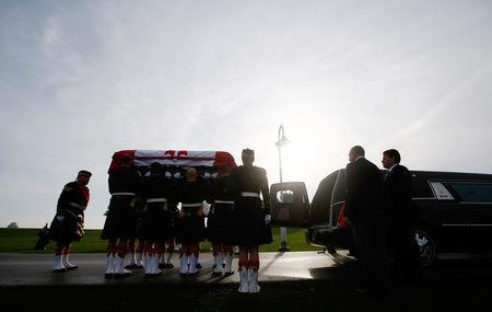 Soldiers load the coffin into a hearse during the funeral procession for Cpl. Nathan Cirillo in Hamilton, Ontario October 28, 2014. REUTERS/Mark Blinch