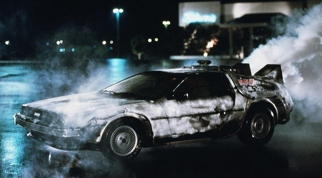 """DeLOREAN DMC-12  As Seen In: <a href=""""http://movies.yahoo.com/movie/1800030906/info"""">Back to the Future Part 1</a>, <a href=""""http://movies.yahoo.com/movie/1800363151/info"""">Part II</a> and <a href=""""http://movies.yahoo.com/movie/1800139450/info"""">Part III</a>  Modified by: Dr. Emmett L. Brown  Key Technical Specs: Goes from 1985 to 1955 in under three seconds.   Before Doc Brown's breakthrough mod -- the flux capacitor -- the iconic DeLorean DMC-12 was the """"it"""" car for movie producers, record execs and other criminals. But this car is capable of so much more. Not only can you impress the ladies along the Sunset Strip, but you can also outrun terrorists, thwart high school bullies, and resolve long-standing oedipal issues.   Available Options: Deluxe edition runs on trash and doesn't need roads."""