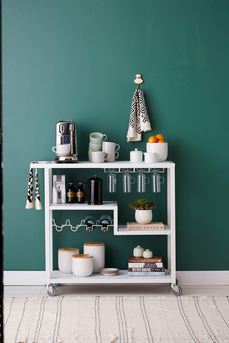 <p>If you're in need of extra space to store your coffee maker and kitchen essentials, a bar cart is a no-fail solution. Add a small succulent and bowl of citrus to create more visual appeal. </p>