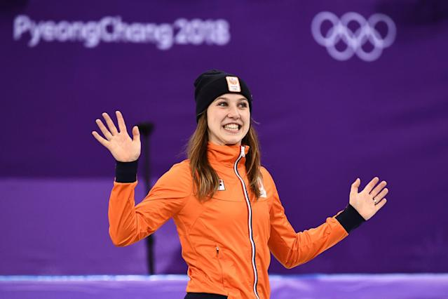 <p>Netherlands' Suzanne Schulting celebrates her gold win at the podium in the women's 1,000m short track speed skating venue ceremony during the Pyeongchang 2018 Winter Olympic Games, at the Gangneung Ice Arena in Gangneung on February 22, 2018. / AFP PHOTO / ARIS MESSINIS (Photo credit should read ARIS MESSINIS/AFP/Getty Images) </p>