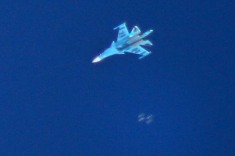 A picture taken on September 7, 2018 shows a Russian Sukhoi Su-34 fighter jet dropping bombs over the Syrian village of Kafr Ain in the northwestern province of Idlib