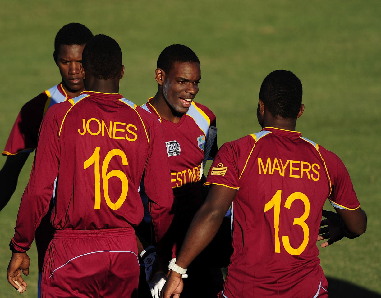 TOWNSVILLE, AUSTRALIA - AUGUST 12:  Justin Greaves (c) of the West Indies is congratulated by team mates after winning the ICC U19 Cricket World Cup 2012 match between the West Indies and India at Tony Ireland Stadium on August 12, 2012 in Townsville, Australia.  (Photo by Ian Hitchcock-ICC/Getty Images)
