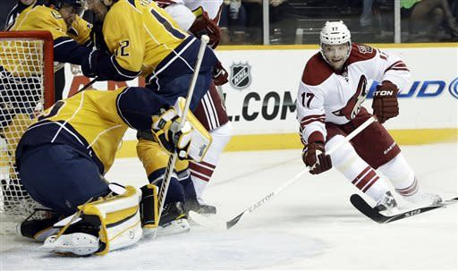 Phoenix Coyotes right wing Radim Vrbata (17), of the Czech Republic, scores his first goal of the game against the Nashville Predators goalie Pekka Rinne, of Finland, left, in the first period of an NHL hockey game on Thursday, March 28, 2013, in Nashville, Tenn. (AP Photo/Mark Humphrey)