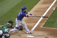 Texas Rangers Todd Frazier hits an RBI double against the Oakland Athletics during the fifth inning of a baseball game in Oakland, Calif., Tuesday, Aug. 4, 2020. (AP Photo/Jed Jacobsohn)