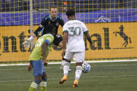Portland Timbers midfielder Eryk Williamson (30) sets up to kick a goal against Seattle Sounders goalkeeper Stefan Frei, center, during the first half of an MLS soccer match, Sunday, Sept. 6, 2020, in Seattle. (AP Photo/Ted S. Warren)