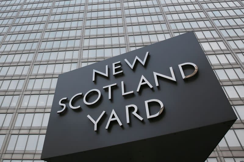 FILE PHOTO: The rotating triangular sign is seen outside New Scotland Yard in central London