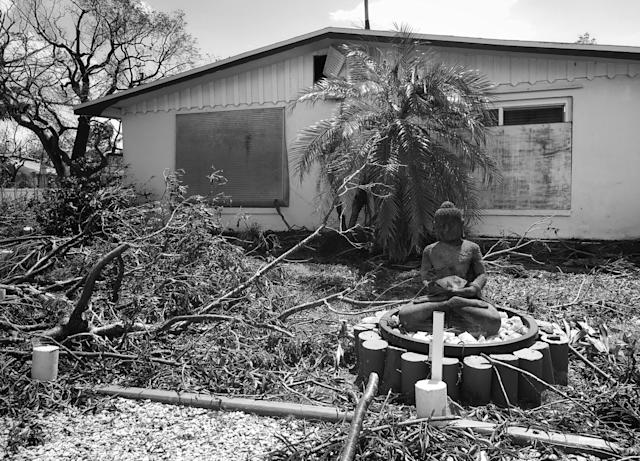 <p>A Buddha statue sits amid storm debris in Goodland, Fla., a city heavily damaged by Hurricane Irma. (Photo: Holly Bailey/Yahoo News) </p>