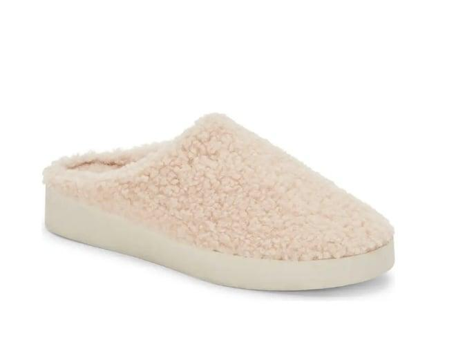 <p>Are they slides? Are they house shoes? Well, <span>Dolce Vita's Varik Faux Shearling Slippers</span> ($70) are a little bit of both - and they look <i>good</i>.</p>