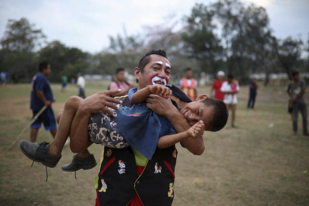 "<p>A boy laughs as he plays with a Mexican clown named ""Chocolate"" at the sports club where Central American migrants traveling with the annual Stations of the Cross caravan have been camped out, at a sports club in Matias Romero, Oaxaca State, Mexico, Wednesday, April 4, 2018. (Photo: Felix Marquez/AP) </p>"