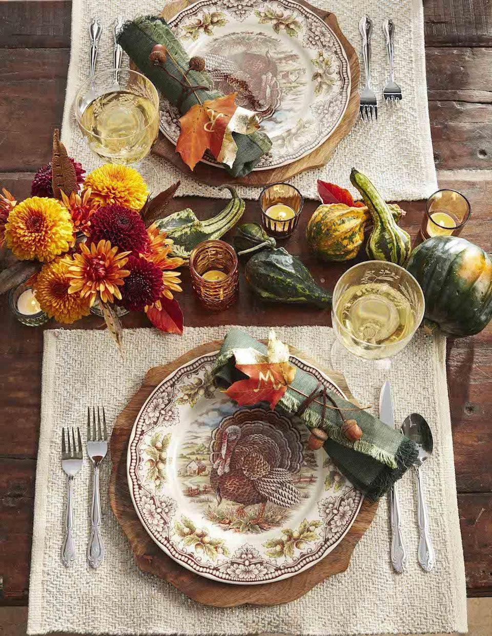 """<p>For a centerpiece that easily transitions between Halloween and Thanksgiving, try a more traditional approach by displaying clusters of gourds, pumpkins, and fall flowers.</p><p><a class=""""link rapid-noclick-resp"""" href=""""https://www.amazon.com/JEDFORE-Simulation-Realistic-Artificial-Decoration/dp/B075JC6T1Z/ref=sr_1_4?tag=syn-yahoo-20&ascsubtag=%5Bartid%7C10050.g.3739%5Bsrc%7Cyahoo-us"""" rel=""""nofollow noopener"""" target=""""_blank"""" data-ylk=""""slk:SHOP MINI GOURDS"""">SHOP MINI GOURDS</a></p>"""