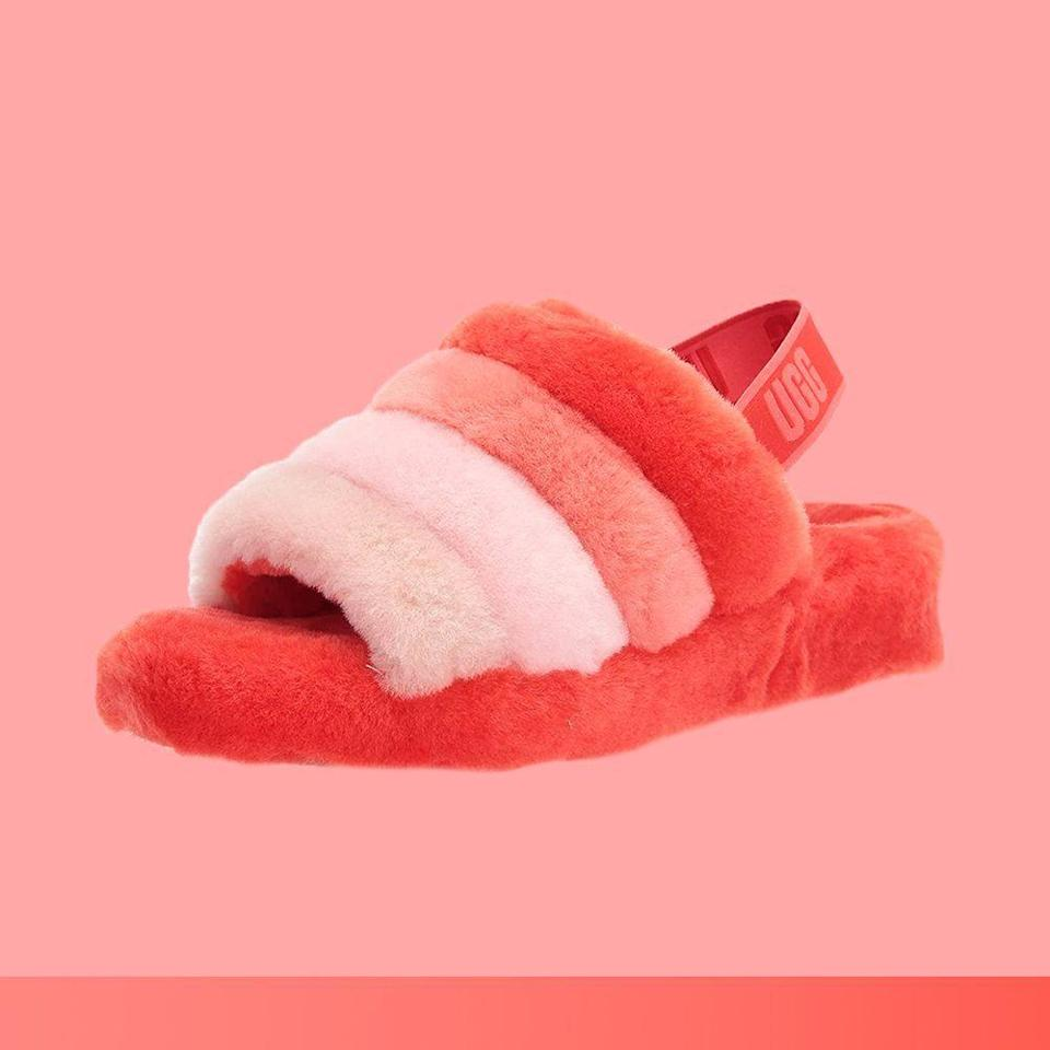 """<p><strong>UGG</strong></p><p>amazon.com</p><p><strong>$99.95</strong></p><p><a href=""""https://www.amazon.com/dp/B0838KXBYM?tag=syn-yahoo-20&ascsubtag=%5Bartid%7C2089.g.376%5Bsrc%7Cyahoo-us"""" rel=""""nofollow noopener"""" target=""""_blank"""" data-ylk=""""slk:Shop Now"""" class=""""link rapid-noclick-resp"""">Shop Now</a></p><p>Regardless of how you feel about the controversial yet comfy UGG boot, the brand's newer slipper/sandal combo has received some of the same clout as the more covered-up classic. In fact, UGG <a href=""""https://www.cnn.com/2020/01/30/cnn-underscored/ugg-fluff-yeah-slide-amazon-dupe/index.html"""" rel=""""nofollow noopener"""" target=""""_blank"""" data-ylk=""""slk:sold more than 100,000 pairs"""" class=""""link rapid-noclick-resp"""">sold more than 100,000 pairs</a> of the Fluff Yeah slipper in 2019 alone.</p><p>It's essentially the UGG boot's breezier, flirtier step sister, combining the same familiar fluffy sheepskin fabric with an airy open-toe, sling-back design.</p>"""