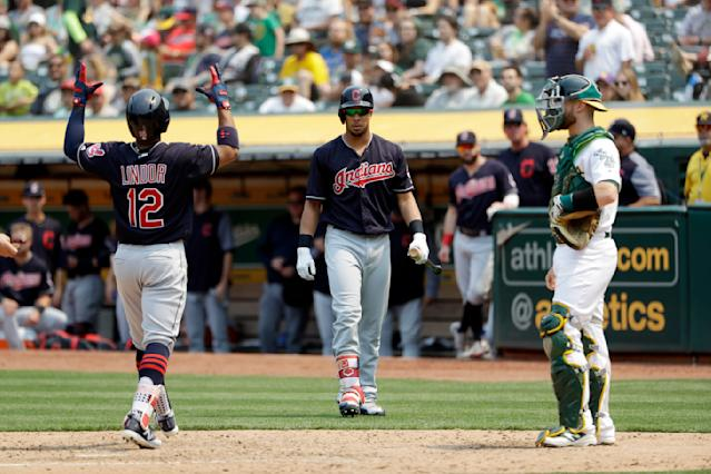 Cleveland Indians' Francisco Lindor (12) celebrates at home plate after his solo home run against the Oakland Athletics during the seventh inning of a baseball game Sunday, July 1, 2018, in Oakland, Calif. (AP Photo/Marcio Jose Sanchez)