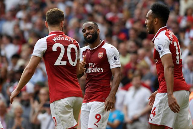 """Soccer Football - Premier League - Arsenal v West Ham United - Emirates Stadium, London, Britain - April 22, 2018 Arsenal's Alexandre Lacazette celebrates with Shkodran Mustafi after scoring their fourth goal Action Images via Reuters/Tony O'Brien EDITORIAL USE ONLY. No use with unauthorized audio, video, data, fixture lists, club/league logos or """"live"""" services. Online in-match use limited to 75 images, no video emulation. No use in betting, games or single club/league/player publications. Please contact your account representative for further details."""