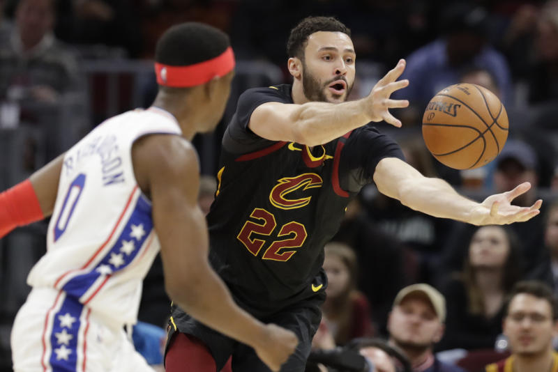 Cleveland Cavaliers' Larry Nance Jr. (22) grabs a rebound ahead of Philadelphia 76ers' Josh Richardson (0) in the second half of an NBA basketball game, Wednesday, Feb. 26, 2020, in Cleveland. The Cavaliers won 108-94. (AP Photo/Tony Dejak)
