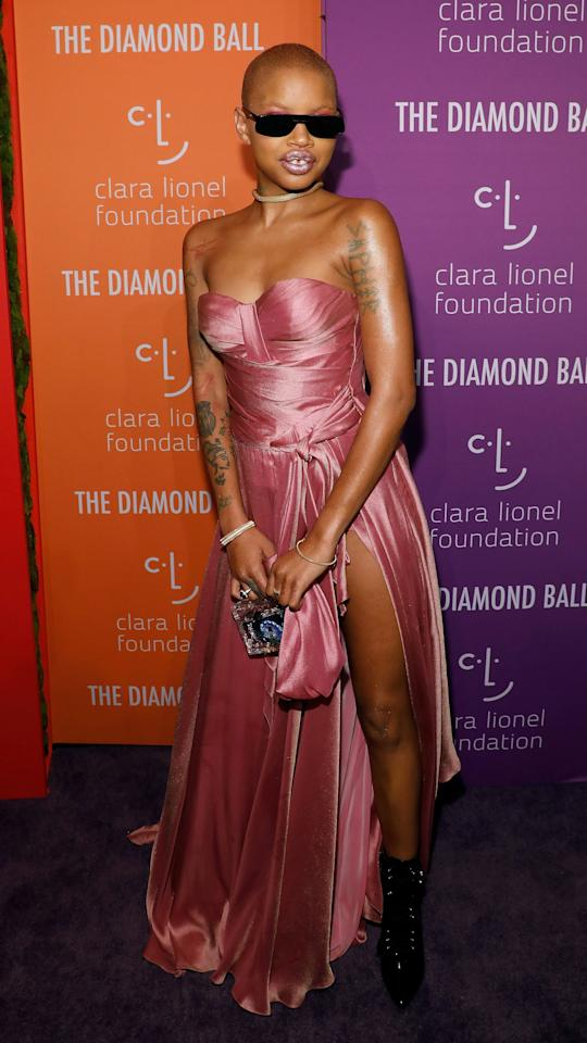 Slick Woods jazzed up her all-pink formal outfit with the addition of some seriously playful shades.