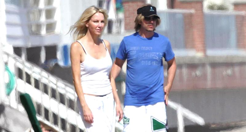 Heather Locklear and David Spade have a beach day in Malibu, Calif., on June 4, 2006. (Photo: AKM-GSI)