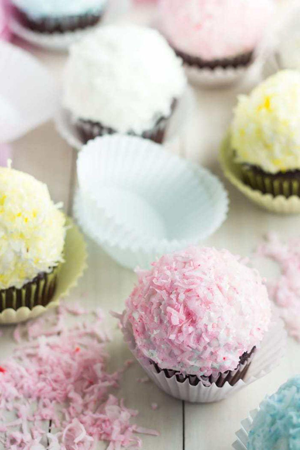 """<p>Your favorite 90s snack has officially been outmatched by these gooey, marshmallow-covered cupcakes. </p><p>Get the full recipe from <a href=""""https://bakingamoment.com/snowball-cupcakes/"""" rel=""""nofollow noopener"""" target=""""_blank"""" data-ylk=""""slk:Baking A Moment"""" class=""""link rapid-noclick-resp"""">Baking A Moment</a>.</p>"""