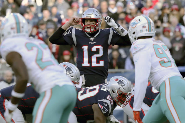 FILE - In this Dec. 29, 2019, file photo, New England Patriots quarterback Tom Brady calls signals at the line of scrimmage against the Miami Dolphins in the first half of an NFL football game in Foxborough, Mass. The Dolphins signed seven potential starters, but none will help their chances of overtaking the New England Patriots in the AFC East as much as Tom Brady did by bolting from Boston for Tampa Bay. (AP Photo/Charles Krupa, File)