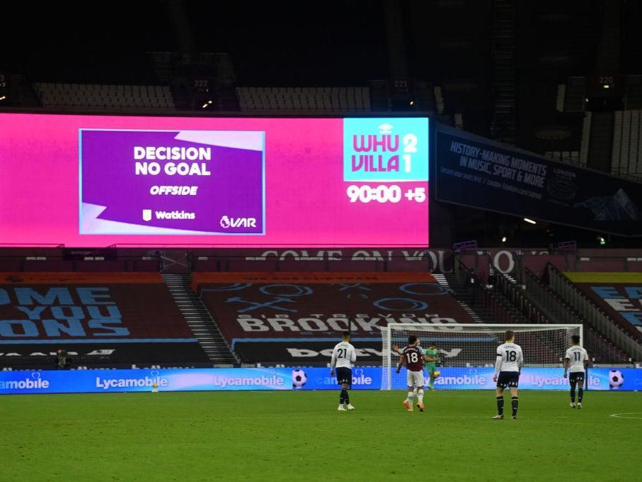 The big screen shows the VAR decision on Ollie Watkins' goal (Getty)