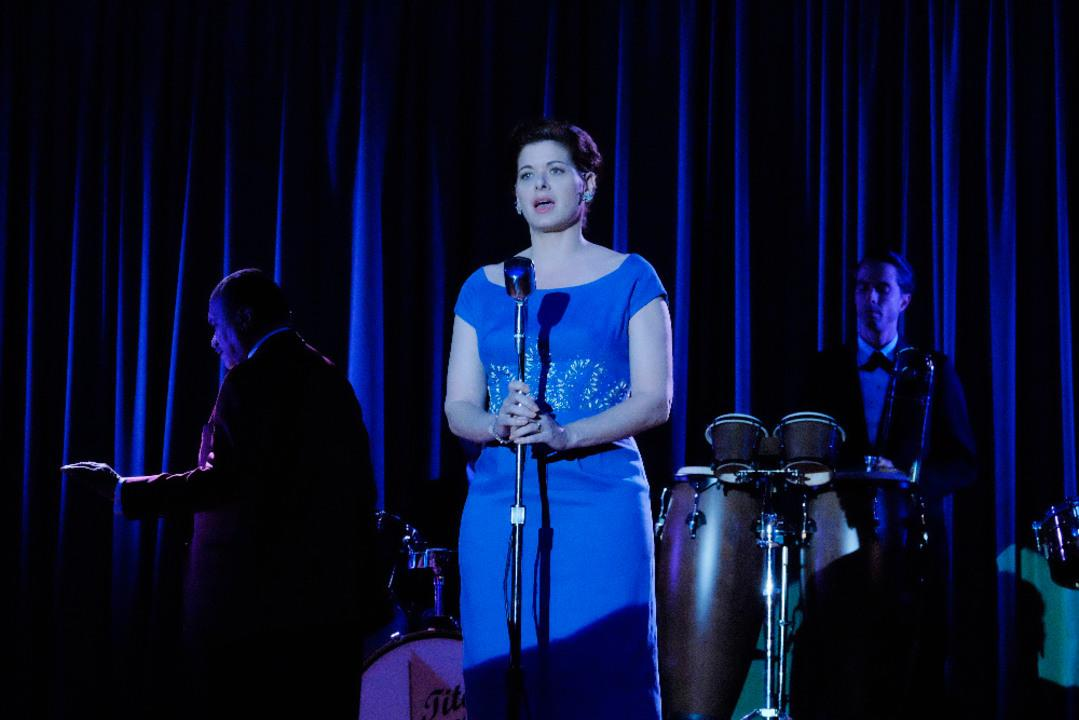 Here's Debra Messing bringing her singing skills into the mix.