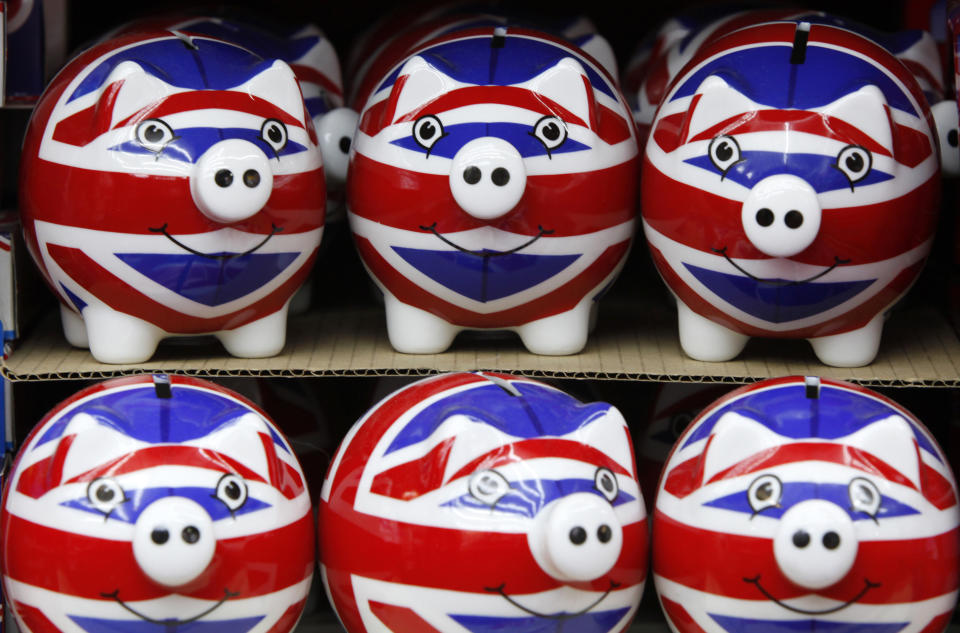 A row of piggy banks adorned with the colours of Britain's Union Jack flag