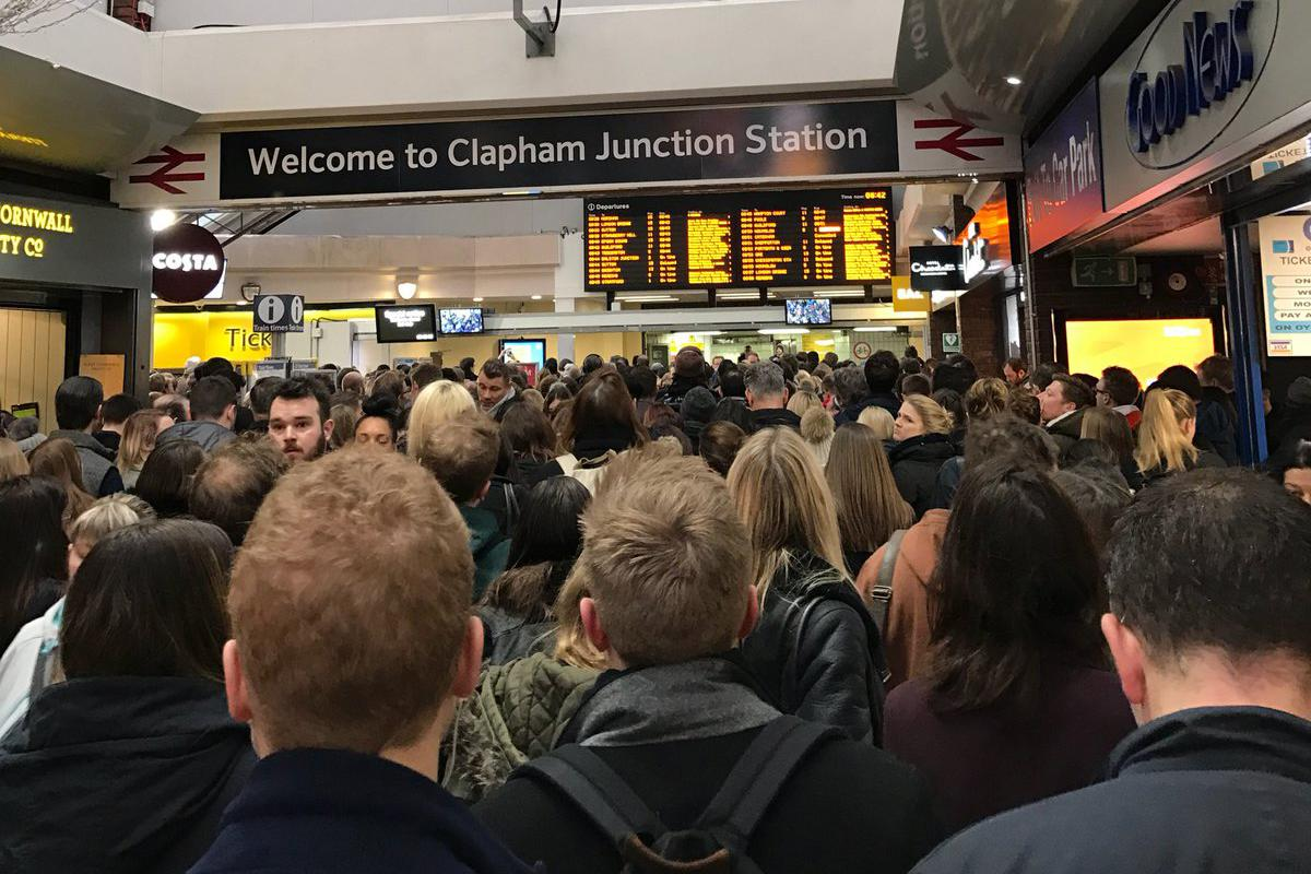 <p>Commuters at Clapham Junction face long waits (Rex) </p>