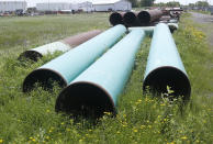 FILE - In this June 29, 2018, file photo, pipeline used to carry crude oil is shown at the Superior, Wis., terminal of Enbridge Energy. The sponsor of the Keystone XL crude oil pipeline says it's pulling the plug on the contentious project, Wednesday, June 9, 2021, after Canadian officials failed to persuade the Biden administration to reverse its cancellation of the company's permit. (AP Photo/Jim Mone, File)